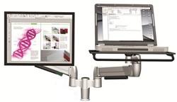Laptop en extra monitor op monitorarm Bakker en Elkhuizen